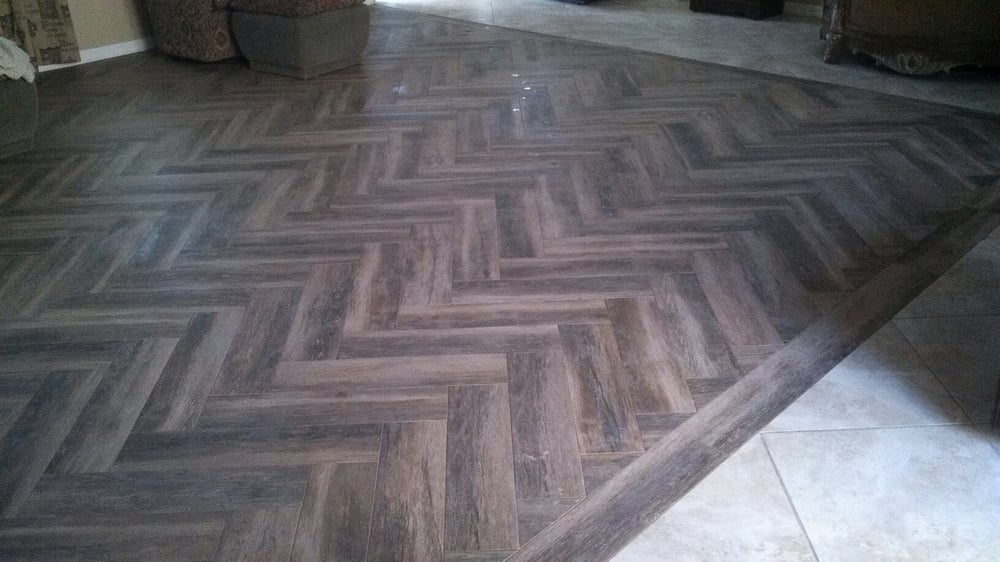 Tile Wood Plank Design Installed As A Herringbone Pattern Using