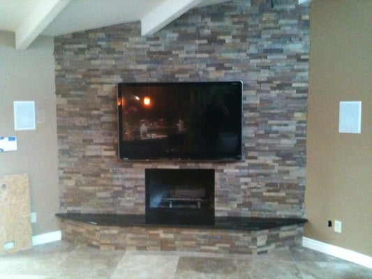 plasma tv installed over fireplace all wiring concealed