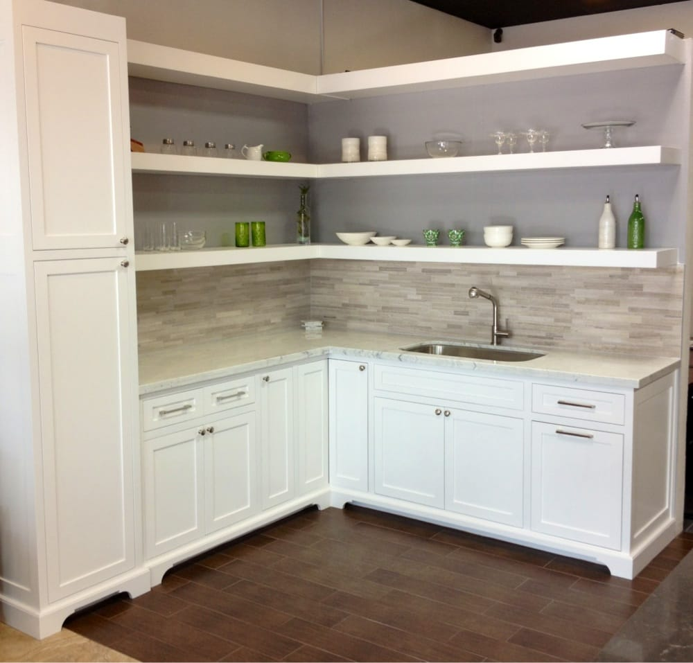 Custom shaker inset cabinetry showroom display with Carrara marble