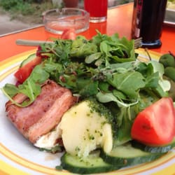 Mixed salad with sheep's cheese wrapped…