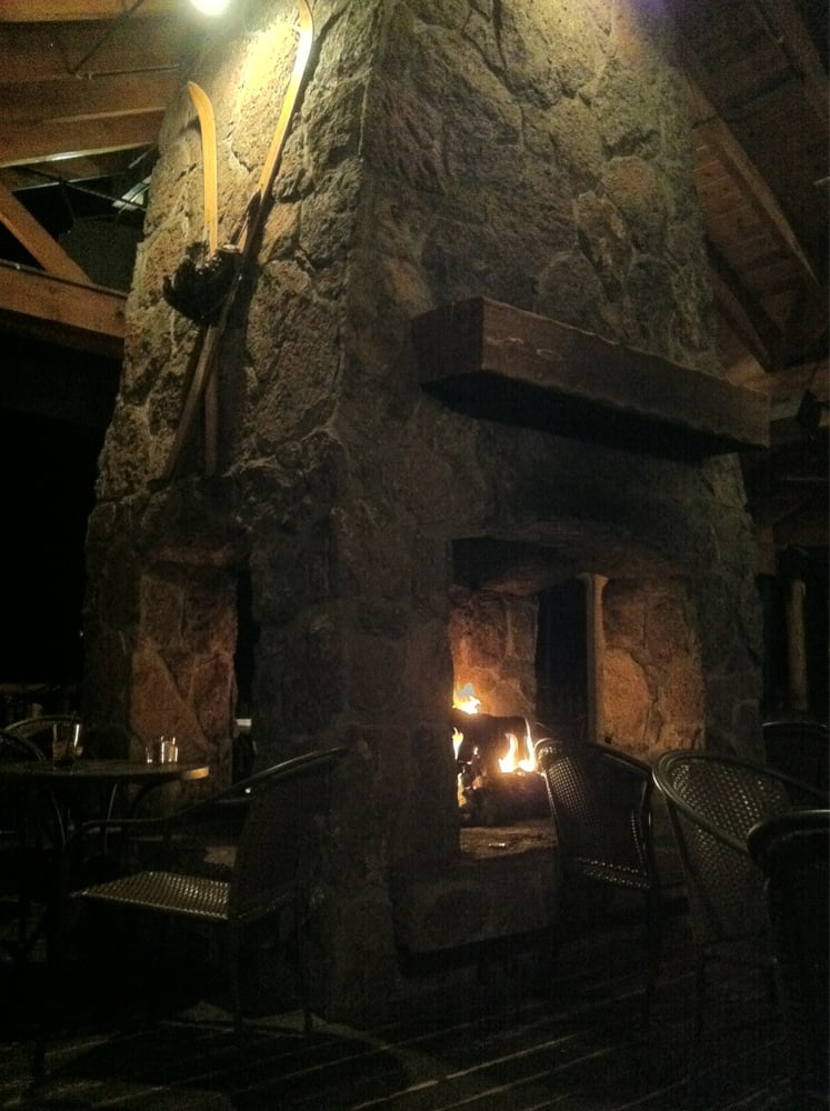 A beautiful rustic four sided fireplace on the patio yelp for Four sided fireplace