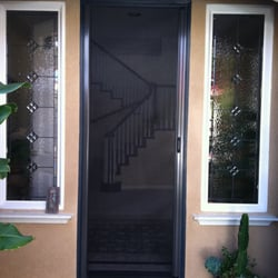 The screen lady 25 photos contractors carlsbad for Roll away retractable screen doors