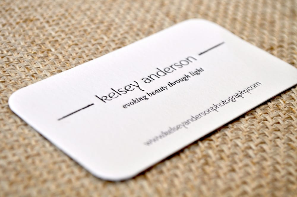 Charcoal gray on white letterpress business card with
