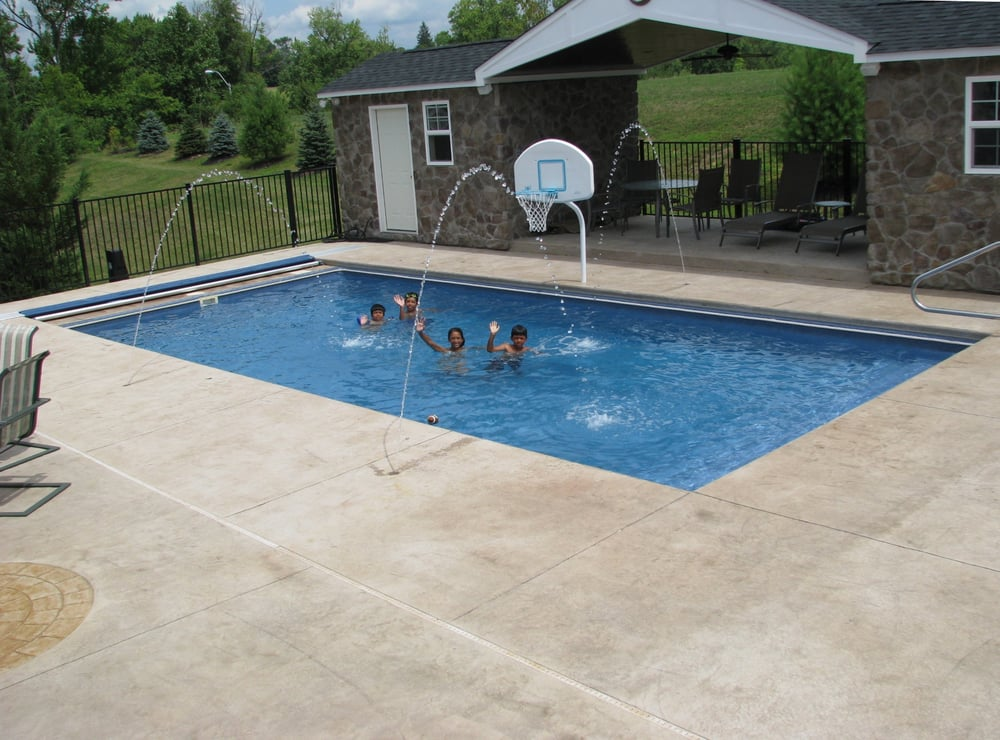 Rectangle fiberglass pool with stamped concrete and for Concrete inground pools