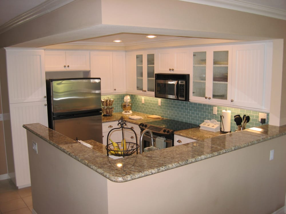 We replaced her old cabinets with white cottage style for Kitchen cabinets 90808