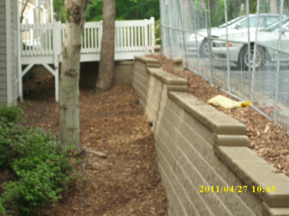 Block Retaining Wall Tie Backs : Tie wall replaced with modular block using earth anchors as backs