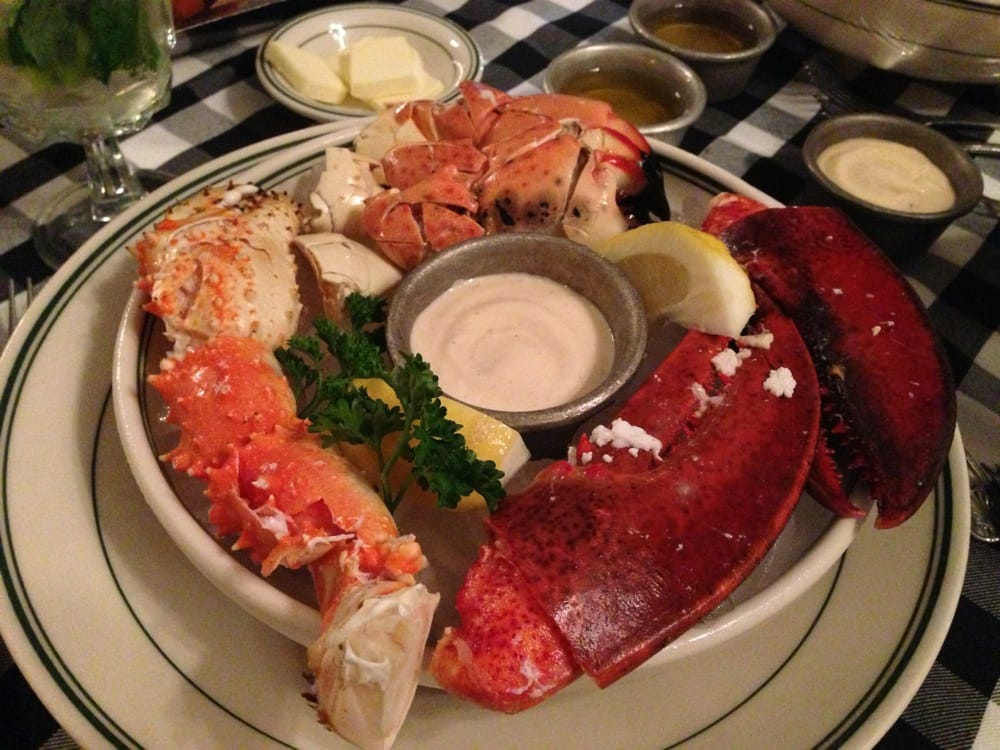 ... FL, United States. Platter of stone crab, king crab and lobster claws