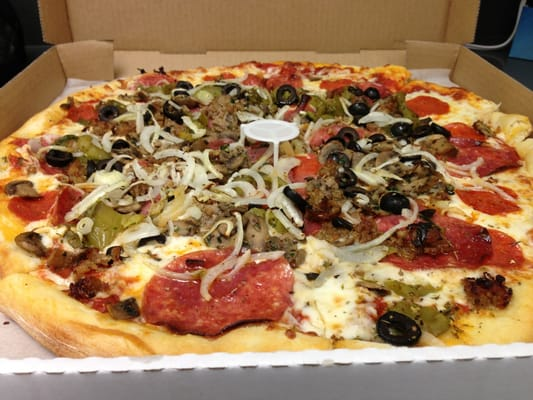 pizza with sausage, pepperoni, mushrooms, salami, bell peppers ...