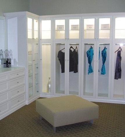 Walk in closet with custom dresser glass door inserts to for California walk in closet
