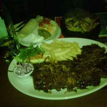 Desperados - Poor image quality, but there is the combo plate of ribs, porkchops, and wings. On the other side are the fajitas! - London, United Kingdom