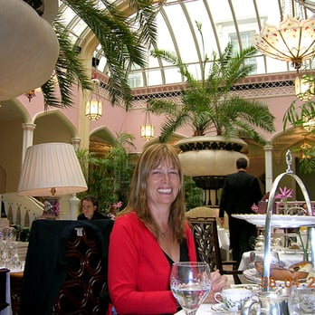 Enjoying afternoon tea in The Conservatory at the Lanesborough Hotel, London
