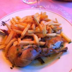 Chicken in sauce with fries