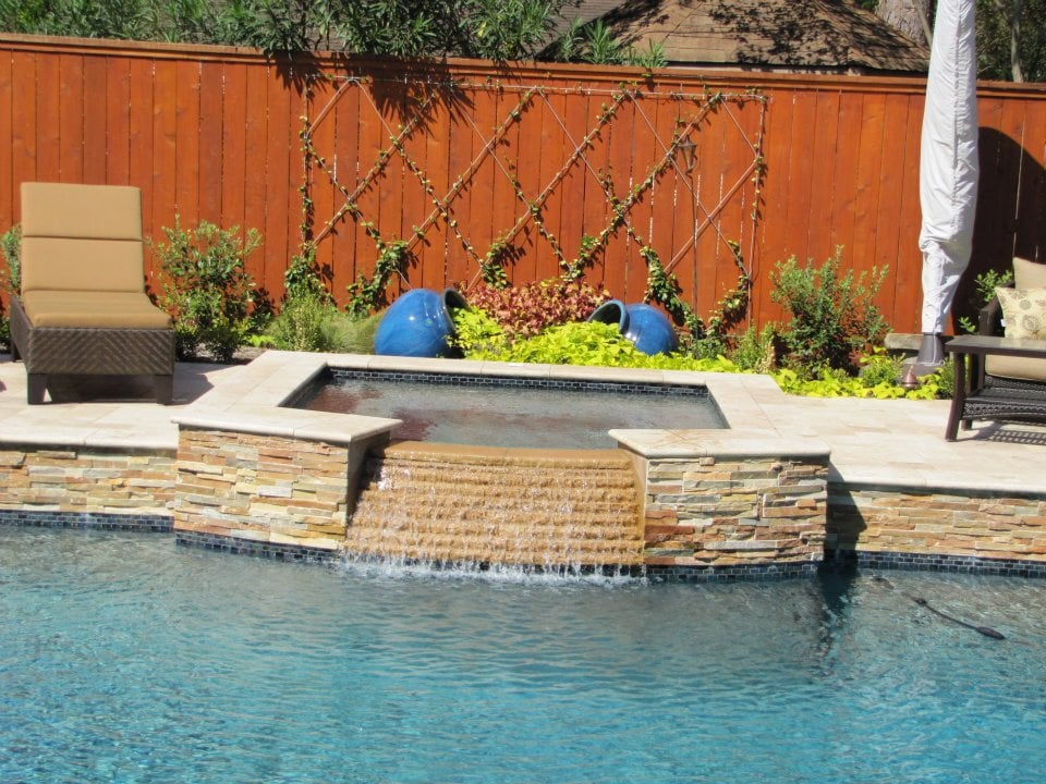 Custom Swimming Pool With Raised Spa Built Of Ledger Wall
