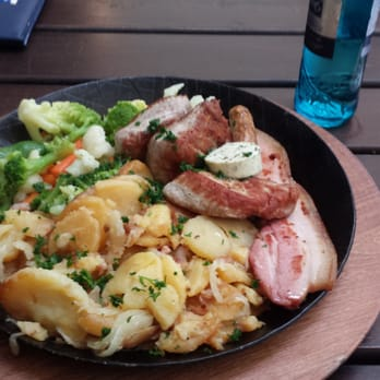 Rats Pfanne - medallions of pork, small bratwurst,  bacon and herb butter, served with fried potatoes and vegetables  Delicious
