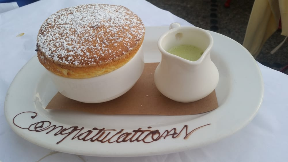 L'Escale - Greenwich, CT, United States. We told them we had recently gotten engaged and they wrote this on our soufflé! How lovely!