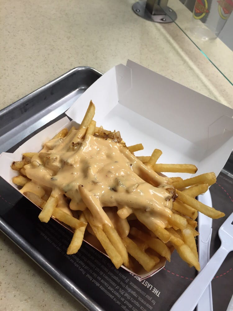 ... United States. Fries with grilled onions and Thousand Island Dressing