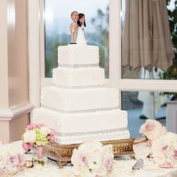 Patty's Cakes and Desserts - our beautiful (and very tasty) wedding cake with our bobblehead cake toppers! - Fullerton, CA, United States