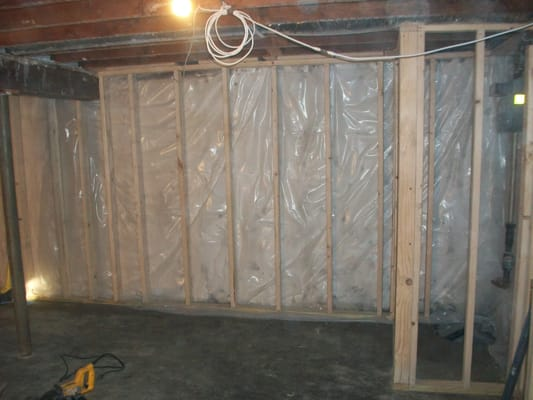 basement remodeling waterproofing concrete walls sealed and vapor