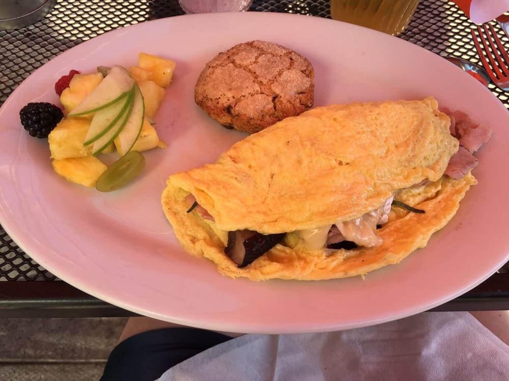 ... Ham, basil, and Brie omelet with fresh fruit and candied apricot scone