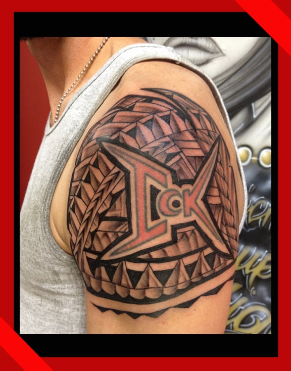 Refurbished lettering with polynesian tattoo done in for Oahu tattoo shops
