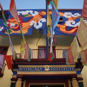 Tibetan Nyingma Institute - Nyingma Institute with prayer flag installation and Year of the Dragon Banner flying for the 40th Anniversary Party. - Berkeley, CA, Vereinigte Staaten