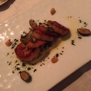 Seared diver scallop with anchovies and capers. 1st course.