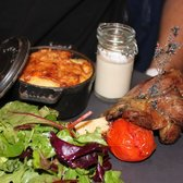 Leg of lamb topped with burning sage, a side of fresh cream and au gratin potatoes