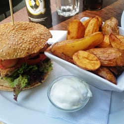 Chicken burger with wedges and sour cream