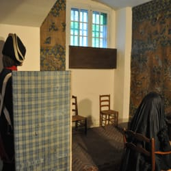 Marie-Antoinette and guard in recreated cell.
