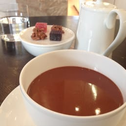 Hot chocolate (Generous portion, too thick) and complimentary jellies and nut bunches in the back (jellies were amazing)