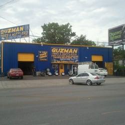 Guzman Tire & Mufflers logo