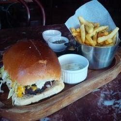 Dry-aged burger on brioche bun, served…