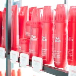 Glam & Glow Hair & Tanning Salon logo
