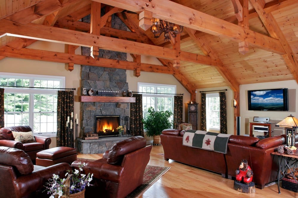 A rustic room addition crafted with post and beam styling for Great room additions