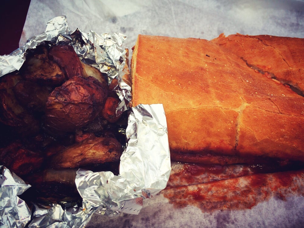 Caveman Kitchen : Dragon wheels on the left and a bbq chicken sandwhich yelp