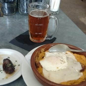 ... Bacon-wrapped dates, polenta with beef and egg, and Anchor Steam beer