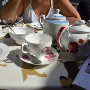 Two unnecessary teapots for two people.