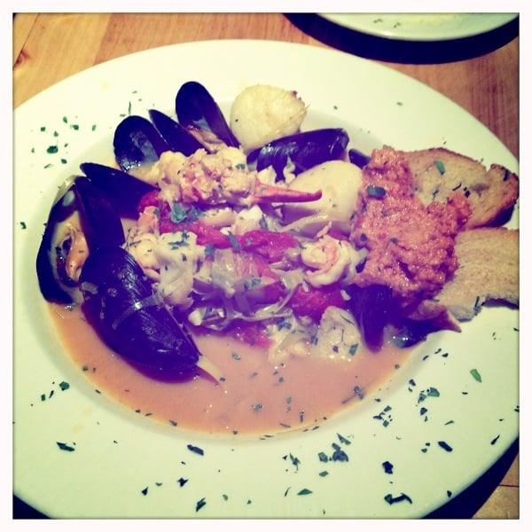 ... tomato saffron soup with mussels, shrimp, scallops, lobster, & sea