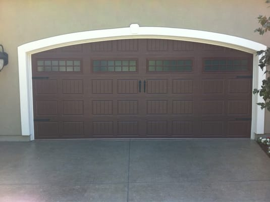 Amarr oak summit collection in dark wood grain color yelp for Wood grain garage doors