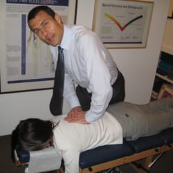 Dr Brian performing a chiropractic…