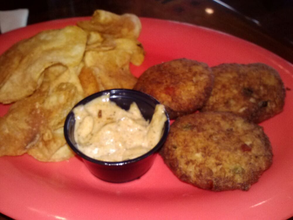 ... States. 3 crab cakes with Old Bay Aioli served with Kettle Chips