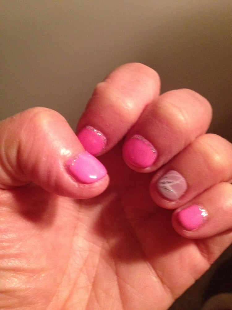 , United States. Shellac manicure by Susan with design on short nails