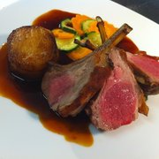 rack of lamb,on kale,spring vegetables,pommes fondant,jus.