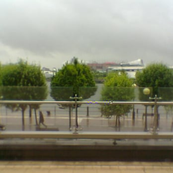 View across the water to Old Trafford, from M&S outlet store windows...