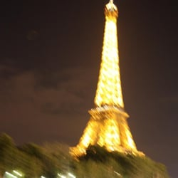 My photographic version of a Monet painting of the Eiffel Tower at night while riding a boat on the Seine River.