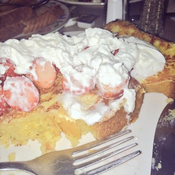 Cornbread French toast with whipped cream and strawberries. I skipped ...
