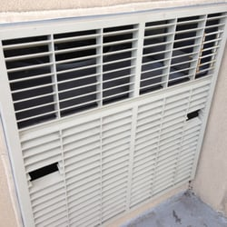 Super Heat - Sergio cut out 2 small louvres to reach in, loosen the screws, & remove the outer vent so he could access & clean the coils. - Chicago, IL, Vereinigte Staaten