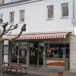 Eingang zur Pizzeria Momenti Italiani