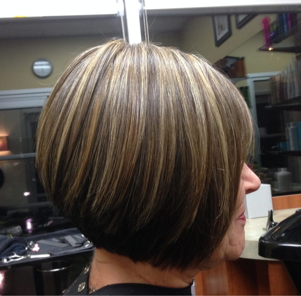 ... Highlights and lowlights mixed with natural color. Cut graduated bob