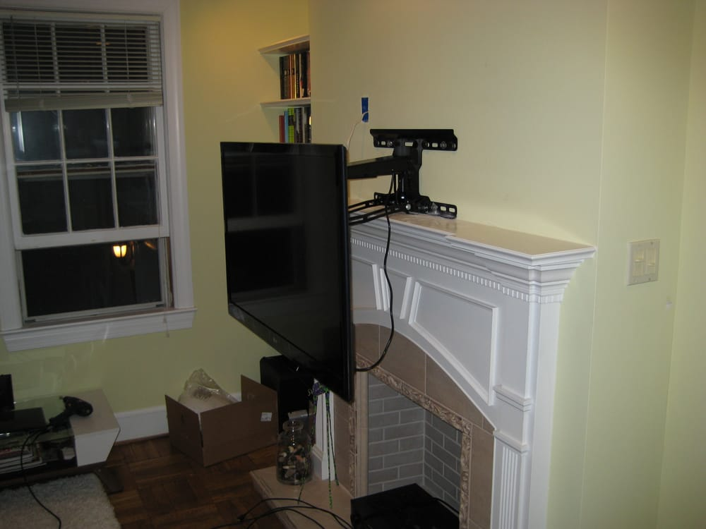 finalizing the finishing steps on a wall mounted tv with a. Black Bedroom Furniture Sets. Home Design Ideas